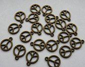 10 Antique Bronze Peace Charms
