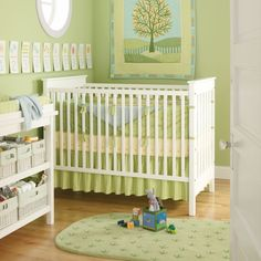 Green Nursery with tree quilt above crib...