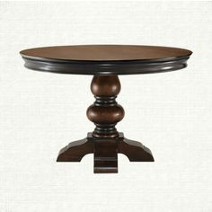 Kingston 48 Dining Table at Arhaus. A gracefully carved apron and solid Mango pedestal base make this British Colonial inspired table an instant classic. Made of the same Mango wood - a hardwood similar to Teak - the sideboard is the perfect comp