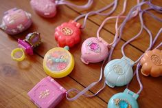 I loved Polly Pocket! And I had the teal one with the jewel on the cover, second from the right.