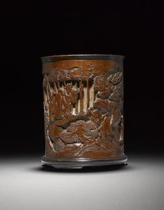 A carved bamboo brushpot  18th Century. 十七/十八世紀 竹雕竹林七賢圖筆筒