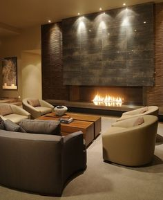 Friedman and Shields - clean contemporary living room featuring accent wall with long fireplace.