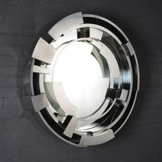 ROUND WALL-MOUNTED FRAMED MIRROR VORTEX VORTEX COLLECTION BY MICHAEL YEUNG DESIGN | DESIGN MICHAEL YEUNG