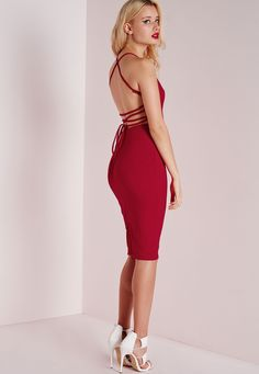 Play up to your feminine side this season in this seriously smokin' red bodycon dress. With v neckline this dress is all about the back with on point lace up strappy detail. Team with strappy heels and clutch for a jaw to the floor finish...