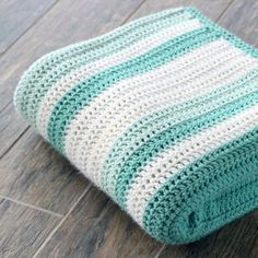 Gorgeous double crochet afghan and pattern. Perfect for a beginner! Link to random stripe generator in post!