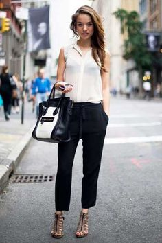 black drawstring drapey pants -- Fashion week, ELLE Magazine (US) Street Chic New York Name: Virginia Slaghekke Work: Model Top: Urban Outfitters Pants: Wilfred Shoes: H Bag: Céline
