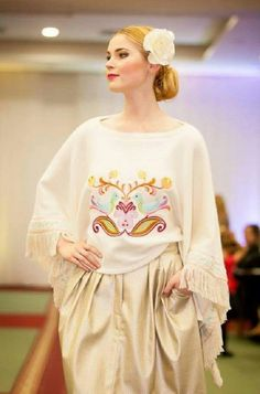 Embroidered poncho pullover and gold colour perforated skirt, both by @jennyjeshko