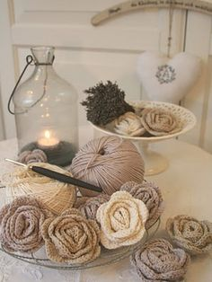 Crocheted rosettes - lovely little decorations - maybe a nice cushion decoration?
