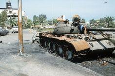 Disabled Iraqi T-55 tank lying along Basra-Kuwait Highway