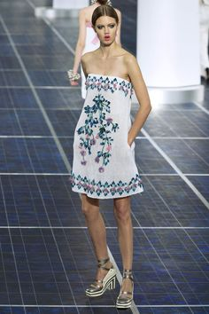 Chanel SS13      The silhouette was dominated by an A-line or a bolero. Lagerfeld loved the skirt     dress—pulled up in a bustier style—as opposed to the shirtdress.  Flowers, pearls