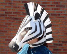 Zebra Mask: Animal masquerade mask. Ready to ship. Need it fast? Message me now and well spring into action for you! Go wild! This fabulous party beast is simply the best designed zebra costume - just slip it over your head, and youre ready to go. Its as light as a feather. Because the head structure is open you can see all around you, and, unlike many other masks, it wont muffle your voice. Do you wear glasses? No problem, they will fit comfortably inside the zebra mask. The zebra is…