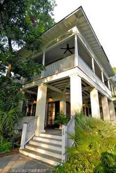 """Here is an example of a contemporary take on the Lowcountry tradition. """"It still has the double porch  and deep overhangs, but twists the traditional details.  The arches on the second-floor porch are a reference back to the arches often found on historical homes throughout Charleston and the Lowcountry,"""" says Thomas."""