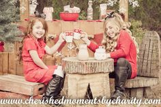 Hot cocoa stand for winter in place of lemonade stand. Sisters, Christmas pose, winter photography ideas. www.cherishedmomentsbycharity.com Facebook.com/cherishedmomentsbycharity