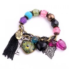 Multi color charm bracelet  An stretchy charm bracelet that will fit around any size wrist!! Jewelry Bracelets