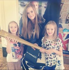 Sisters of Louis Tomlinson holding the Olympic torch