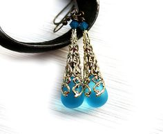Blue Glass earrings made with czech glass Teardrop beads, swarovski crystals and czech quality filigree findings in Golden color. Blue and Gold