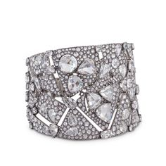 CARNET. AN ARTICULATED DIAMOND CUFF BRACELET Designed as a tapering openwork cuff, composed of abstract angular sections pavé-set with rose-, circular- and pear-shaped diamonds, accented with large triangular and round and heart-shaped rose-cut diamonds connected by fancy-cut stones, mounted in white gold, signed Carnet, 2014. Total diamond weight 48.17 carats.