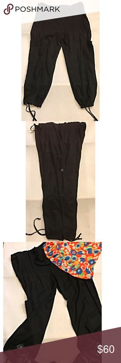 """Tianello Tencel and Rayon Active Pants Ankle Ties This is a pair of Tianello black pants which can be worn for yoga, Tai chi or anytime comfort and style come together. Details include ties at ankle and waist, gathered pockets and buttons.  Fabric is a wonderful blend of garment dyed Tencel and rayon and preshrunk and machine washable, tumble dry. Size  Medium. Length is 36.5"""", inseam is 24"""", waist is 36"""" and rise measures 13.5"""". These are designed to be roomy. All color descriptions and…"""