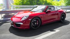 2015 PORSCHE 911 Targa Review - After three generatios of sliding glass tops, the Targa's roof is back to its retro look.