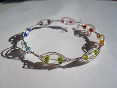 Armreif aus Silberdraht und bunten Glasperlen von Behrenperlen auf DaWanda.com