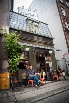 Owner Leif Thingtved sits outside the world's smallest hotel and coffee shop