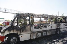 The burned out shell of a bus in Guadalajara. Photo by Hector Hernandez.