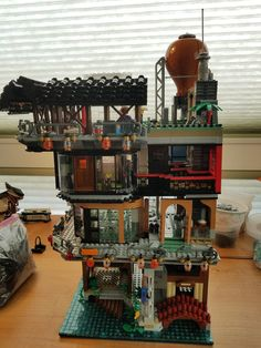 Jewelry, Open Space, Bakery corner shop and side of moped bike store in view. Lego Ninjago City, Lego City, Lego Movie Sets, Lego Humor, Lego Minifigure Display, Lego Dragon, Lego Challenge, Lego Pictures, Lego Modular