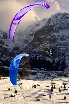 Paragliders in the Swiss Alps above the Grindelwald valley, Switzerland