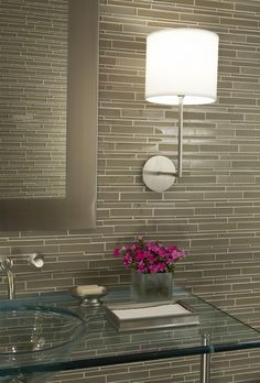 Gorgeous wall tile, love the glass counter and sink...and the sconce....good-looking bath