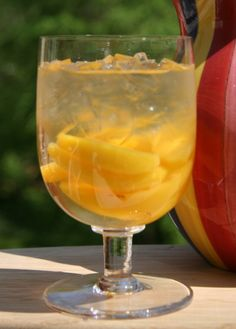 Cheap white wine and peaches: 'white peach Sangria'...