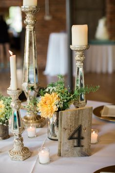 wooden table number - photo by Casto Photography http://ruffledblog.com/high-tide-inspired-wedding-in-greenville
