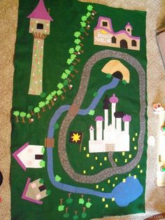 Love this felt play mat idea, although maybe something not princess themed, but more gender neutral. A piece of green cloth for a base instead of felt? Tangled felt play mat. http://www.mydecoupagedlife.com/2011/03/tangled-activity-mat.html