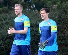 Wojciech Szczesny Photos Photos - Per Mertesacker and Wojciech Szczesny make their way to the training field during a Arsenal Training Session ahead of their Champions League fixture against Borussia Dortmund on September 15, 2014 in St Albans, England. - Arsenal Training Session