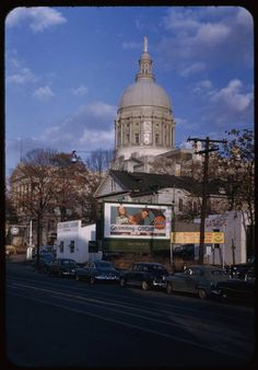 The Capital building in Atlanta,  GA before the gold was added to the dome.  The gold was added in 1958/59 and came from Dahlonega, Georgia