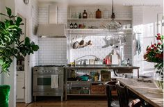 If I could pick any kitchen design, it would be something like this (from a kitchen in Stockholm), the European style of mixing and matching, I love it.