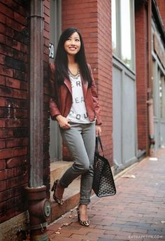 Leather jacket, white shirt, golden necklace, grey jeans and cheetah skin loafers street style for fall