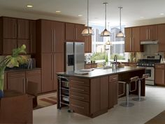 kitchen example displaying the armstrong cabinet style calibra ii with the autumn brown finish. beautiful ideas. Home Design Ideas
