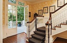Back staircase in a neo Georgian style home in Greenwich, Connecticut.