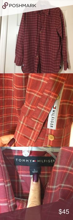"""TOMMY HILFIGER BUTTON DOWN COLLAR - LS - Size LG The """"forever classic"""" TOMMY HILFIGER 22""""!long sleeved, button down shirt!  Has a nice sized pocket on the left side of the chest. Machine washable. Main color is a dark red with thin lines for plaids, such as tan and a blue/green color Tommy Hilfiger Shirts Casual Button Down Shirts"""