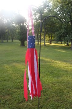 Patriotic Wind Sock made from a tin can and crepe paper. This is a great DIY craft for the Fourth of July, Memorial Day, Veteran's Day or just to celebrate America!