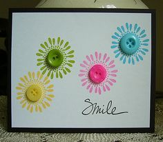 handmade greeting card ... clean and simple design ... fanciful daisies stamped in brith colors ... each with a matching button ... cute!