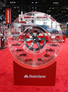 Who said display cases have to be square?  Check out this fascinating trade show display from State Farm!
