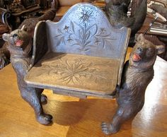 A Rare Musical Miniature Bear Bench Carved in Switzerland, circa 1890. Eidelweiss is carved into the seat and back.  Height: 18 inches Width: 24 inches