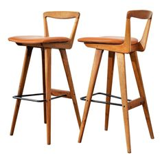"""Denmark  1950s  These Danish bar stools, designed by Henry Rosengren Hansen for Brande Møbelfabrik, incorporate some really cool forms, with great craftsmanship and attention to detail. One's eye is particularly drawn to the way the tubular metal stretcher doubles as a footrest, and also balances the """"woodiness"""" of the rest of the chair."""