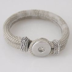 The main picture shows the closed bracelet with a silver place to Snap your Chunk Charms. The second picture shows the bracelet closure and the
