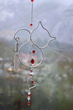 Suncatcher Glass Sun-Catcher Decorative by CoirniniCompany on EtsyBeautiful Suncatcher created with silver wire, beaded with glass beads, whiskers for cuteness and heart charm for love. All of our sun-catcherscan be made with Copper wire too Cat Crafts, Wire Crafts, Jewelry Crafts, Sun Catchers, Copper Wire Art, Wire Ornaments, Snowman Ornaments, Bijoux Diy, Beads And Wire