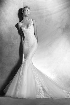 Lace and Chantilly lace mermaid wedding dress with a round neckline and sheer illusion tulle straps decorated with lace appliqués. Atelier Pronovias, 2016