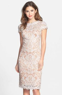 Exquisite, beautifully symmetrical lace is fashioned into a breathtaking sheath dress. The illusion yoke and cap sleeves lend a refreshing sheerness to the polished look while detailed trim softens the overall silhouette.  39 1/2 length. Hidden back-zip closure. Lined. 60% rayon, 20% nylon, 20% polyester. Dry clean. By Tadashi Shoji; imported. Special Occasion.