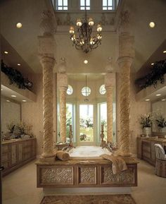 WOW,THIS 2 STORY MASTER BATHROOM HAS LOTS OF CHARACTER FROM ALL THE ARCHITECTURAL FEATURES AND DESIGNS,FROM THE WINDOWS TO THE BATHTUBS COLUMNS.BEAUTIFUL FOR A TUSCAN OR OLDWORLD DECOR.CHERIE