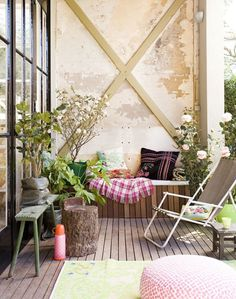 You may think a barren wall and some flowers and plants don't make a good enough balcony décor; you are wrong. You can still make it look great by choosing just the right type of potted plants and flowers and making use of the rustic bare wall. Choose closely themed furniture to go with the wall.